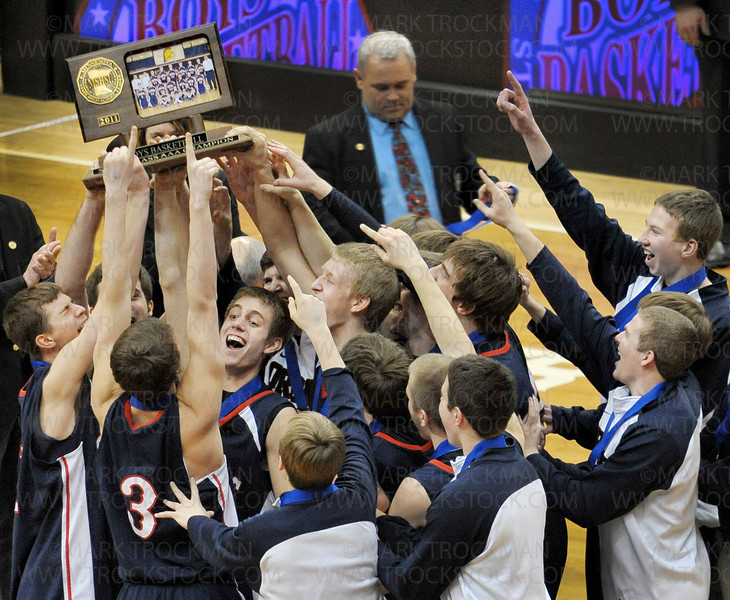 Trophy time.  The Spartans show off their newly acquired state Class 3-A basketball championship trophy after the awards ceremony Saturday, Mar. 26, after beating Columbia Heights 85-76 at Target Center in Minneapolis.