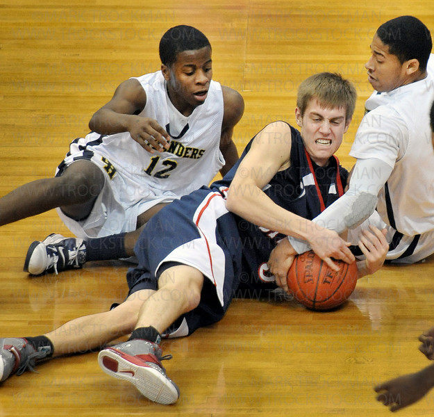 Orono guard Jordan Smith, center, fights Columbia Heights players Rodrick Logan, left, and Dominique Galloway for a loose ball Saturday, Mar. 26, at Target Center in Minneapolis. The Spartans beat Columbia Heights 85-76 to win the state Class 3-A championship.