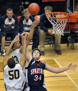 Spartans guard Erik Peterson (34) fights for an offensive rebound with Columbia Heights' Jordan Mills (50) and Zach Lofton in the second half Saturday, Mar. 26, at Target Center in Minneapolis. The Spartans beat Columbia Heights 85-76 to win the state Class 3-A championship.