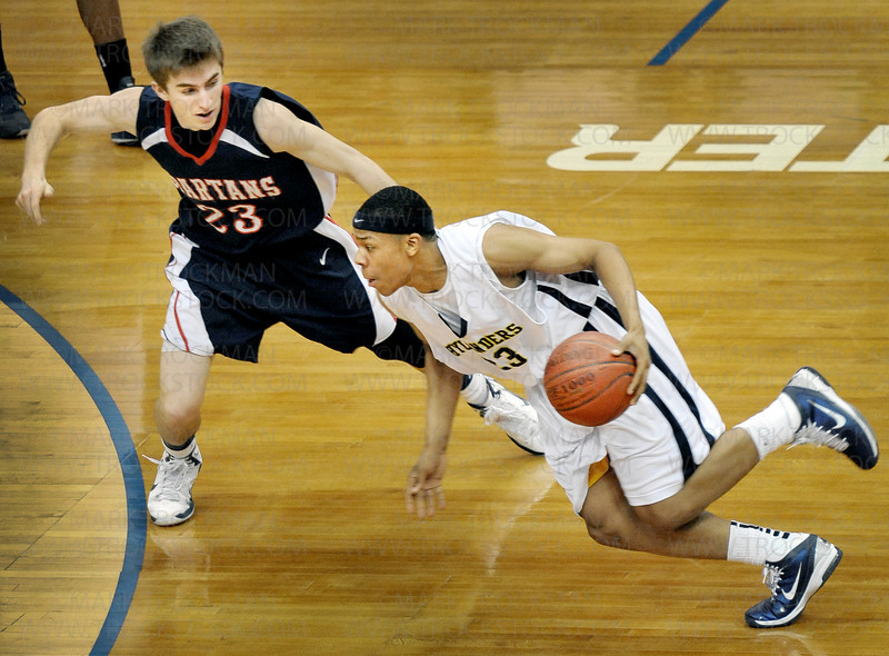 Orono senior guard Chase Myhran (23) tries to impede Columbia Heights' Zach Lofton's progress Saturday, Mar. 26, at Target Center in Minneapolis. The Spartans beat Columbia Heights 85-76 to win the state Class 3-A championship.