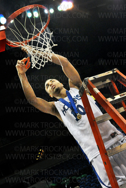 Hopkins senior forward Joe Coleman takes his turn cutting the net from the rim after the awards ceremony for the Royals 64-52 Class 4-A state championship victory over Eden Prairie Saturday, Mar. 26, at Target Center in Minneapolis.