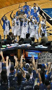 The 2011 Hopkins boys basketball team takes their Class 4-A Minnesota state championship trophy to their adoring fans after beating Eden Prairie 64-52 Saturday, Mar. 26, at Target Center in Minneapolis.