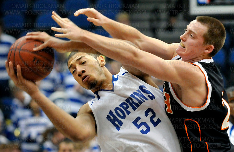Hopkins senior Royce White, left,  scored 14 points and grabbed six rebounds in the Royals game against St. Cloud Tech.  White also registered three blocks, three assists and two steals in the Royals  55-36 victory at the Target Center in the state semifinals on Thursday, March 26.