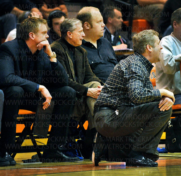 The Hopkins coaching staff watches their team finish off Lake Conference rival Edina by beating the Hornets 69-55 and securing the Royals a fourth straight state tournament berth with their section 6-4A win Tuesday, March 13, at Osseo High School.