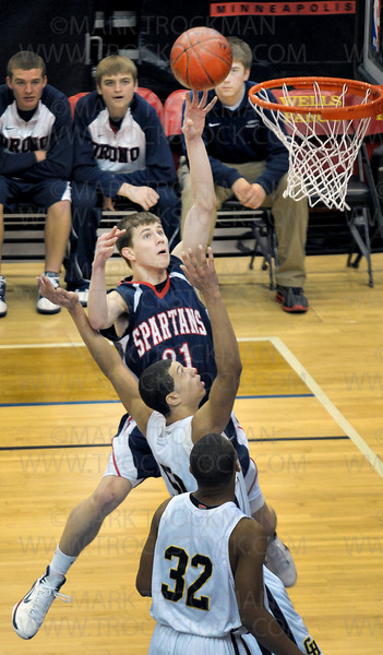 Orono junior guard Brady Wohler, top, watches his second half layup  Saturday, Mar. 26, at Target Center in Minneapolis. The Spartans beat Columbia Heights 85-76 to win the state Class 3-A championship.