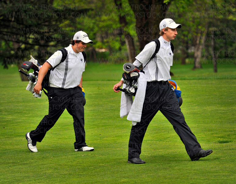 Wayzata's number one golfer Kyle Beversdorf, right, walks the fairway with teammate Tyler Lowenstein at Minnetonka Country Club May 13.  The Trojans beat conference rival Minnetonka 210-217.