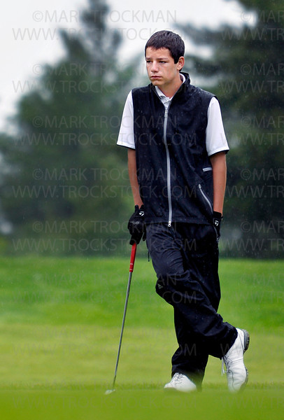 Wayzata freshman Jack Holmgren watches match play in the rain at Bunker Hills Golf Course Wednesday, June 15, in Coon Rapids.  Holmgren tied for 7th place at the State Class 3A Boys' Golf Tournament with a two day combined score of 147.  The Wayzata Boys team tied Rogers for 1st place in the team competition with a total score of 592.