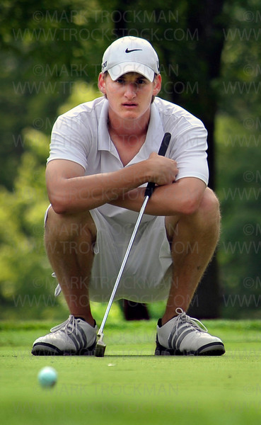 Orono senior Patrick Johnston sizes up a putt at Ridges at Sand Creek in Jordan, Minn., Thursday, June 16.  Johnston finished the Class 2A Boys' State Golf Tournament in 35th place with a combined score of 156.