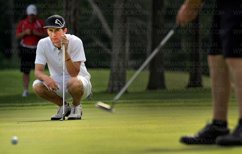 Orono senior Dakota Clark waits patiently on the green to putt at Ridges at Sand Creek in Jordan, Minn., Thursday, June 16.  Clark finished the Class 2A Boys' State Golf Tournament tied for 19th place with a combined score of 151.