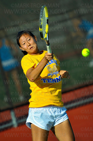 Wayzata sophomore Kelly Yang returns a serve from Hopkins sophomore Ida Ramic in their #1 singles match Thursday, Sept. 13, in Minnetonka.  Yang beat Ramic in straight sets, 6-3, 6-2.