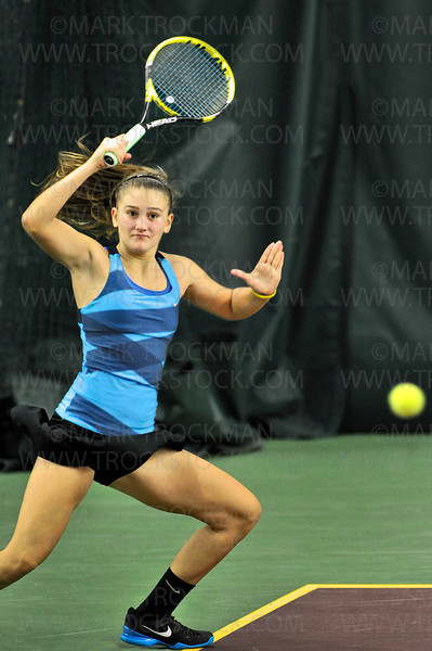 Minnetonka No. 1 doubles players Theresa Tebon slaps a forehand during the girls' state tournament quarterfinal.  The Skippers trounced their opponents from Stillwater 6-2, 6-0, Tuesday, Oct. 23, at Baseline Tennis Center in Minneapolis.