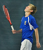 Trojans #2 singles player Dustin Britton shows the agony of defeat after losing a point to The Hornet's Tyler Kuck in section play Thursday, May 24, at Baseline Tennis Center in Minneapolis.  Wayzata's Britton succumbed to Edina's Kuck 2-6, 7-5, 6-7.