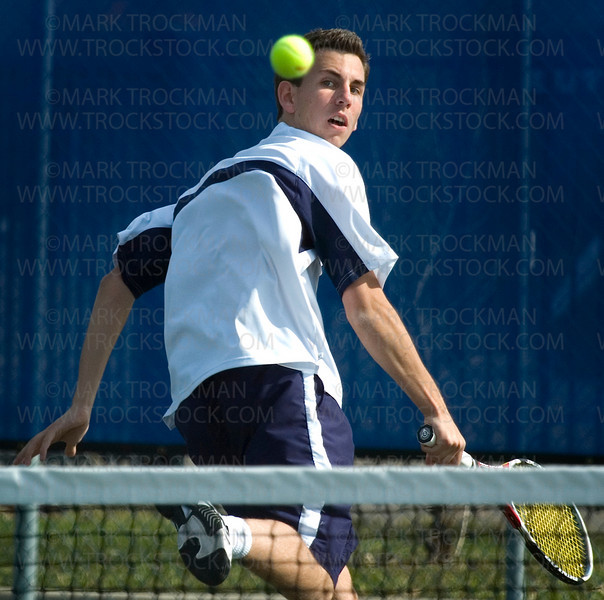 Orono's Dennis Martin returns the ball on the run Wednesday, April 23 at Minnetonka HS. Martin bumped his season record to 7-1 on the season with his defeat of Michael Tebon 6-2, 6-2 at No. 1 singles.