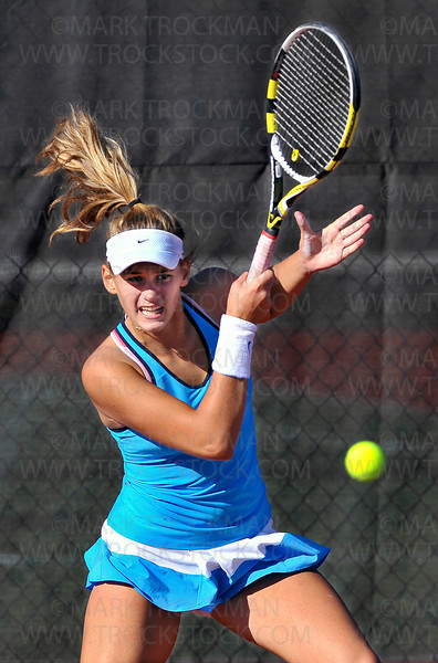 Hopkins #1 singles player, sophomore Ida Ramic, smashes a forehand at her Wayzata opponent, sophomore Kelly Yang, in their Lake Conference match in Minnetonka Thursday, Sept. 13, 2012.  Ramic lost to Yang in straight sets, 6-3, 6-2.