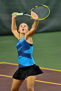 Minnetonka No. 1 doubles player Theresa Tebon waits for a high volley during the girls' state tournament quarterfinal. The Skippers trounced their opponents from Stillwater 6-2, 6-0, Tuesday, Oct. 23, at Baseline Tennis Center in Minneapolis.
