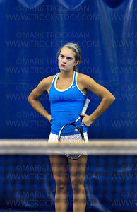 Blake team captain, and one-half of the Bears No. 1 doubles team, Maddy Hall, contemplates a missed shot against Rochester Lourdes at Reed Sweatt Tennis Center in Minneapolis Wednesday, Oct. 26.  Hall and doubles teammate Ellie Rudd defeated their Rochester Lourdes foes, 6-2, 6-2.  Blake beat Rochester Lourdes 6-1 in the state tournament team competition.