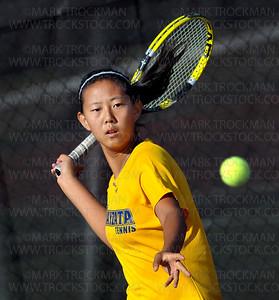 Wayzata freshman Kelly Yang crushed her #1 singles opponent, Hopkins freshman Ida Ramic, 6-1, 6-0, in Lake Conference play at Hopkins High School Tuesday, Sept. 13, 2011, in Minnetonka.