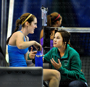 The Blake School's girls tennis head coach Jeannette Vickman, right, talks strategy with the Bears No. 1 singles player, junior Claire Carpenter, during her match against Rochester Lourdes' Margaret Pearson Wednesday, Oct. 26, at Reed Sweatt Tennis Center in Minneapolis.  Carpenter lost to Pearson, 4-6, 6-1, 10-8.  Blake beat Rochester Lourdes 6-1 in the state tournament team competition.