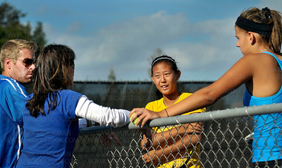 Hopkins #1 singles player, freshman Ida Ramic, right, disputes a game score with Wayzata's #1 singles player, freshman Kelly Yang, center, Wayzata's coach, Marci Weiner, second from right, and Hopkins head coach Todd Roudabush Tuesday, Sept. 13, in Minnetonka.  Yang defeated Ramic 6-1, 6-0.