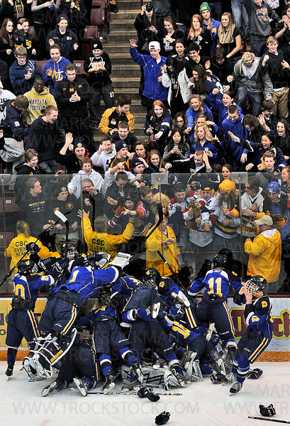 The Trojans squad celebrates a goal against Benilde-St. Margaret's with their fans Wednesday, Feb. 27., at Mariucci Arena in Minneapolis.  Wayzata beat the Red Knights 5-2, clinching the Section 6-2A championship.