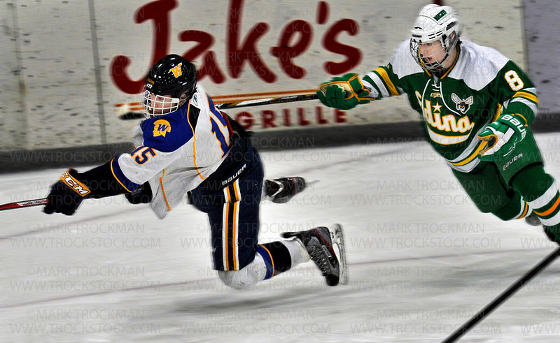 Trojans sophomore forward Matthew Freytag (15) goes airborne fighting for possession against Edina junior Cullen Raasch in first period action, Saturday Jan. 26, at Plymouth Ice Center.  The Hornets won their Lake Conference duel, beating Wayzata at home 5-4.