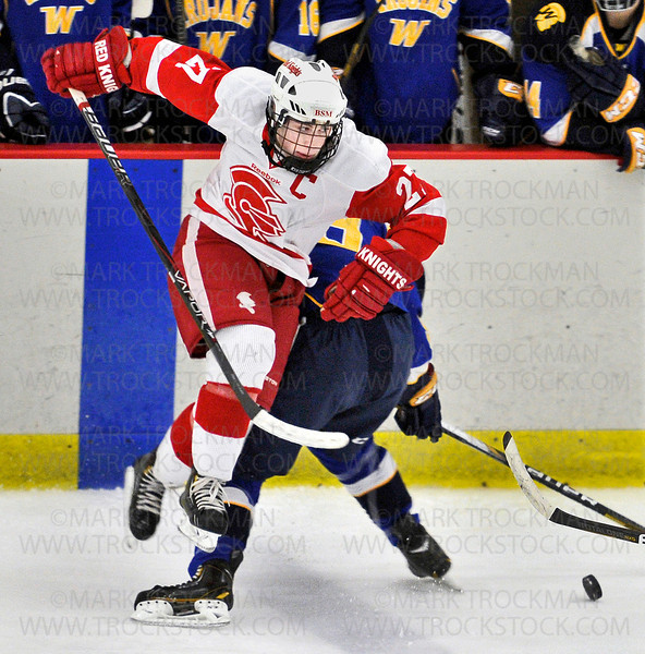 Benilde-St. Margaret's senior forward Dan Labosky (27) hops over a Wayzata opponent in the first period Thursday, Jan. 3, at the St. Louis Park Rec Center.  The Red Knight's beat the Trojans 5-2.