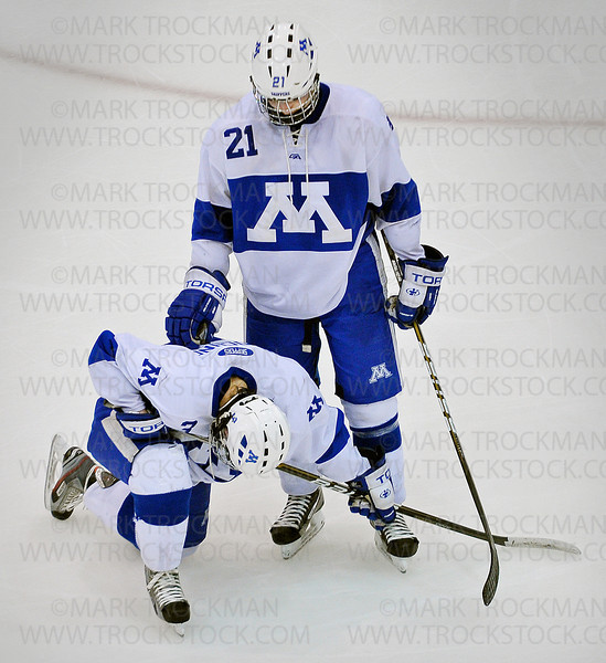 Minnetonka junior defenseman Jimmy Schuldt, standing, comforts teammate Michael Prochno immediately following the Skippers section 6-2A tournament loss to Benilde-St. Margaret's 5-1 Wednesday, Feb. 29, at Mariucci Arena in Minneapolis.