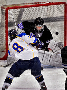 Trojans senior forward Kage Tiller (8) slaps a shot at Buffalo goaltender Tim Harkess in first period action.  Wayzata beat the Bison 7-1 in their Turkey Trot Tournament match-up Saturday, Nov. 26, at Plymouth Ice Arena.