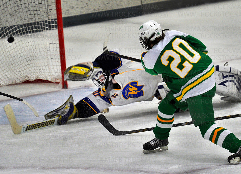 Edina sophomore forward Dylan Malmquist (20) beats Trojans goaltender Aaron Dingmann for the first of his two goals against Wayzata Saturday Jan. 26, at Plymouth Ice Center.  The Hornets won their Lake Conference duel, beating the Trojans 5-4.