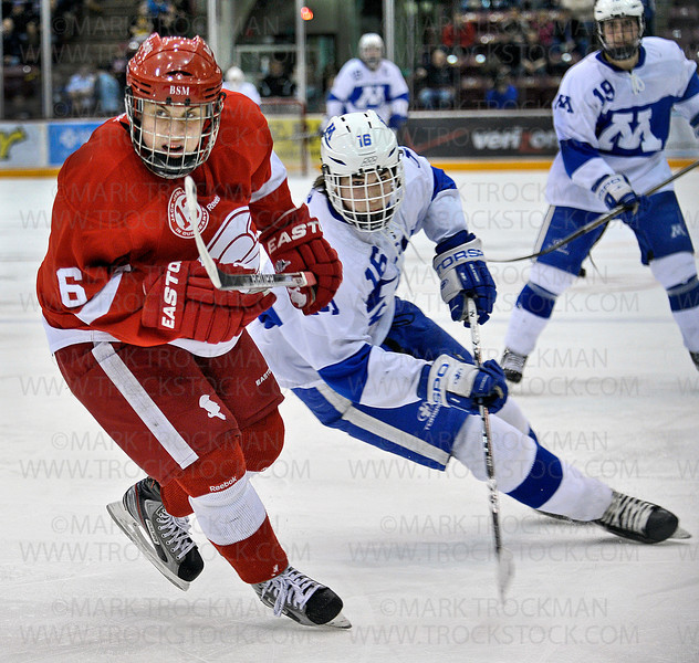 Skippers sophomore defenseman Jack Ramsey (16) moves up-ice with Red Knight's sophomore forward Ben Newhouse (6) in the second period of Minnetonka's 5-1, Section 6-2A tournament final loss Wednesday, Feb. 29, at Mariucci Arena in Minneapolis.