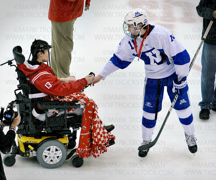 Skippers senior defenseman Jack Teal, right, shakes hands with Benilde-St. Margaret's Jack Jablonsky as Minnetonka players are awarded their silver medals after losing the Section 6-2A tournament  to the Red Knights 5-1 Wednesday, Feb. 29, at Mariucci Arena in Minneapolis.