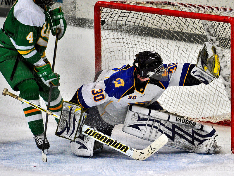 What at first looked like an Edina goal against Wayzata senior goalkeeper Aaron Dingmann (30) was not to be, and play resumed immediately Saturday Jan. 26, at Plymouth Ice Center.  The Hornets beat the Trojans 5-4.