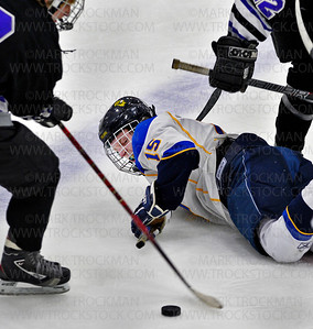 Wayzata senior forward Kenzie Vold (15) isn't happy about being checked to the ice by the Buffalo defense in the second period during Turkey Trot Tournament action Saturday, Nov. 26, at Plymouth Ice Arena.  Vold answered back by scoring a goal in the third period of the Trojans 7-1 trashing of the Bison.