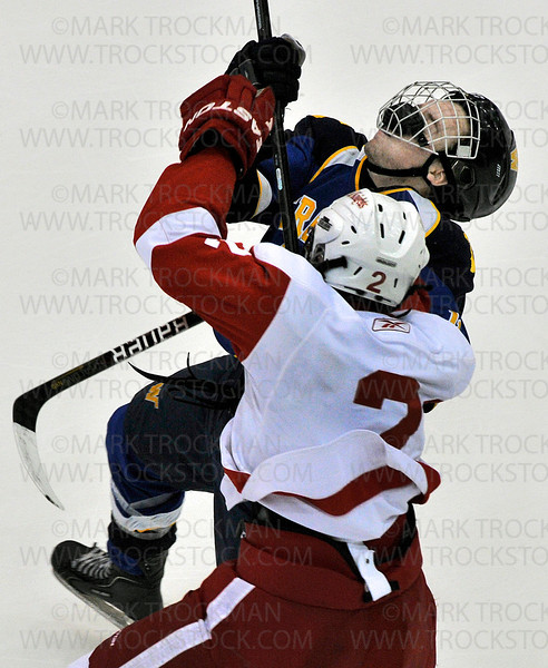 Red Knights senior defender Chris Hickok, right, gives Wayzata junior Chase Heising an uppercut in the 3rd period during the Trojans 5-2, Section 6-2A championship defeat of Benilde-St. Margaret's Wednesday, Feb. 27, at Mariucci Arena in Minneapolis.