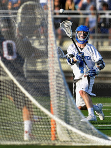 Skippers senior attacker Teddy O'Reilly, right, scores one of his four goals against Eden Prairie at Robbinsdale Armstrong High School Thursday, May 31, in Plymouth.  Minnetonka lost the Section final 11-6 to the Eagles.