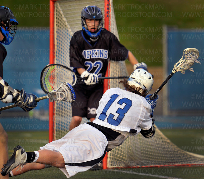 Skippers senior middie Connor Gatenby (13) lays it out in a scoring attempt against Hopkins Thursday, May 19, at Minnetonka.  Tonka shellacked their Lake Conference rivals 16-4.