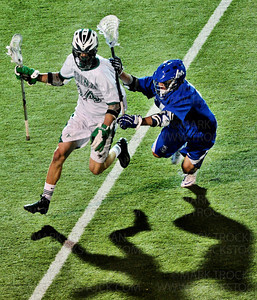 Skippers senior attacker Teddy O'Reilly, right, shoves Hornets midfielder Ted Goltzman in the first half of Minnetonka's 7-5 defeat of Lake Conference foe Edina Tuesday, May 15, at Edina Community Center.