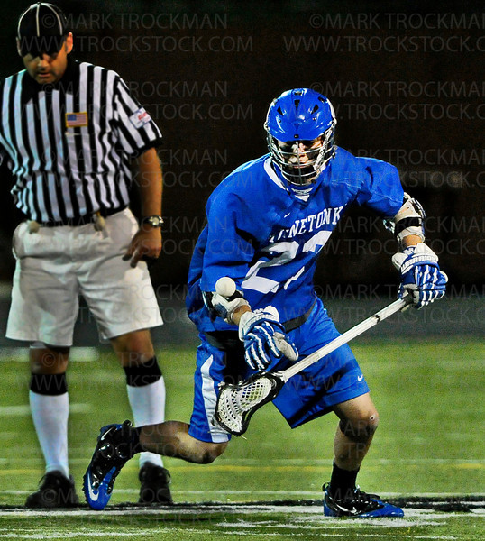 Tonka sophomore midfielder Matthew Boyce gets control of the ball from a first half faceoff after Boyce scored against Edina Tuesday, May 15, 2012.  Minnetonka beat the Hornets 7-5 in Lake Conference play.