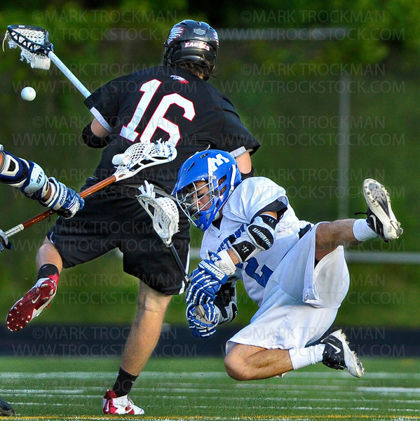 Minnetonka sophomore attacker Paul Ruelle, right, is tripped up by a close encounter with an Eden Prairie defender in the first half of the Skippers 11-6 Section final loss to the Eagles Thursday, May 31, at Robbinsdale Armstrong High School in Plymouth.
