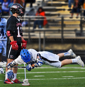 Skippers senior attacker Teddy O'Reilly gets laid out horizontally early in the match against Eden Prairie at Robbinsdale Armstrong High School Thursday, May 31, in Plymouth.  O'Reilly scored four of Minnetonka's six goals in their 11-6 Section final loss to the Eagles.