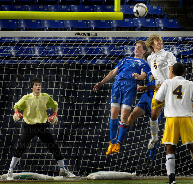 Blake goalie Tips Jackley, left, concentrates as defender Michael Ankeny heads the ball away after a Totino-Grace corner kick Wednesday, Oct. 29 at the H.H.H. Metrodome in downtown Minneapolis.  Blake won the state championship 1-0.