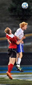 Skippers senior midfielder Dane Falline, right, heads a goalie-kick away from Coon Rapids senior attacker Andrew Kruseman Saturday, Sept. 15, in Minnetonka.  Minnetonka lost to the Cardinals 2-1.