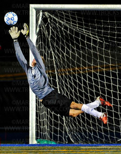 Minnetonka senior goalkeeper Griffin Struyk launches himself off the turf to keep Coon Rapids from scoring another goal against the Skippers at Einer Anderson Stadium Saturday, Sept. 15, in Minnetonka.  The Skippers lost to the Cardinals 2-1, in non-conference play.