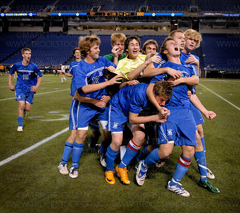 Members of the Blake Bears 2008 Minnesota state boys 1A soccer championship team celebrate their win midfield after defeating Totino-Grace 1-0 Wednesday, Oct. 29 at the H.H.H. Metrodome in downtown Minneapolis.