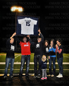 Colton Gleason's family show the huge, Orono home-crowd, his retired #15 jersey during a half-time memorial ceremony for their recently fallen friend, classmate and teammate in one-sided,  deadly attack in St. Cloud just days before.  The Spartans  blanked Glencoe-Silver Lake 4-0 Thursday, Sept. 27, at Orono.