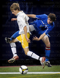 Blake senior forward Eric Barry, right,  collides with Totino-Grace's Tim Pairitz as the 2008 state boys 1A soccer final got under way Wednesday, Oct. 29 at the H.H.H. Metrodome in downtown Minneapolis, Minn.  Blake won the championship 1-0.