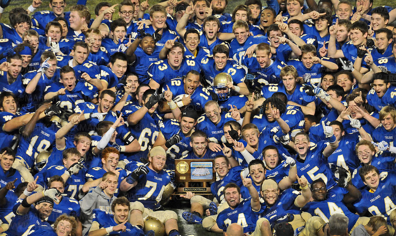 The 2010 Wayzata football squad shows off their hard-fought, class 5A, first-place trophy after beating Rosemount 31-14 in the Prep Bowl at the Metrodome in Minneapolis Friday, Nov. 27.
