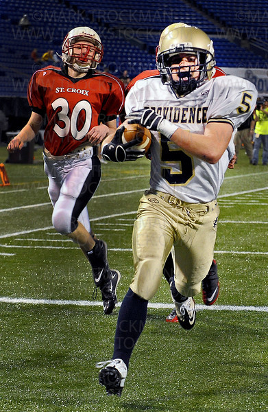Lions senior running back San Pellegrene crosses the goal line for six points against St. Croix Lutheran in the class 3A state tournament semifinal in the Metrodome in Minneapolis Saturday, Nov. 19.  Providence Academy lost to the Crusaders 58-29.