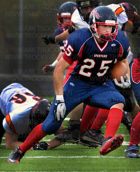 Spartans junior sensation, tight end Tom Wachman (25) advances the ball through the Grand Rapids defense on his way to one of his three touchdowns in Orono's 35-21 win against the Thunderhawks Friday, Oct. 7, in Long Lake.