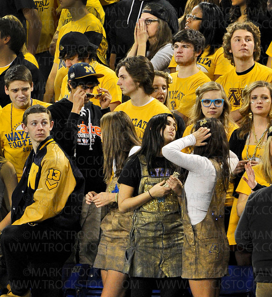 The Wayzata faithful show their disappointment near the end of the Trojans 21-7 state football semifinal loss to Eden Prairie Friday, Nov. 16, at the Metrodome in Minneapolis.